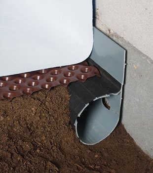 Closeup of a crawl space drainage system installed in Kellogg