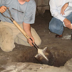 Digging a hole for the engineered fill used in a crawl space support system installation in Latah