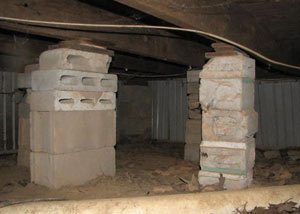crawl space repairs done with concrete cinder blocks and wood shims in a Sandpoint home