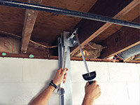 Straightening a foundation wall with the PowerBrace™ i-beam system in a Latah home.