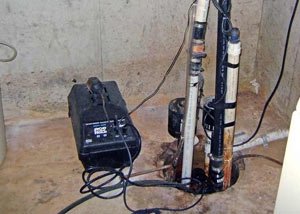 Pedestal sump pump system installed in a home in Colbert