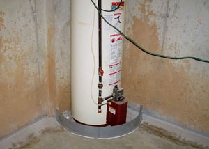 A water heater in Otis Orchards that's been protected by the FloodRing® and a perimeter drain system.