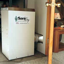 A basement dehumidifier with an ENERGY STAR® rating ducting dry air into a finished area of the basement  in Elk