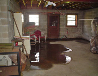 a flooded basement floor in a Elk home