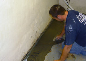 Restoring a concrete slab floor with fresh concrete after jackhammering it and installing a drain system in Chattaroy.